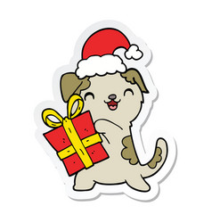 sticker of a cute cartoon puppy with christmas vector image