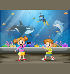 Children take pictures in aquarium vector