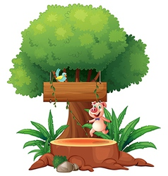 A pig and a bird under the big tree vector image