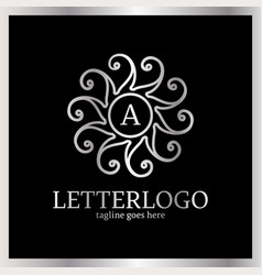 Sun heart abstract logo letter a in middle luxury vector