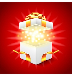 Opened gift box on red background vector image