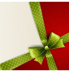 Christmas card with green polka dots bow vector image