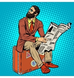 Bearded hipster traveler reading a newspaper vector image vector image
