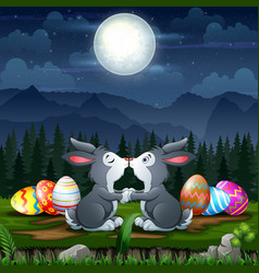 Happy bunnies kissing with easter eggs in easter e vector