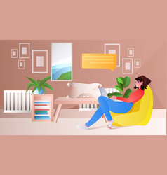 Woman sitting on beanbag and using laptop chat vector