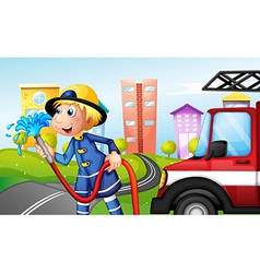 A fireman with a hose at the street vector image vector image