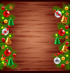 Christmas tree branches on wood background vector