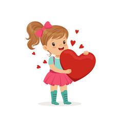 Sweet little girl holding red heart happy vector