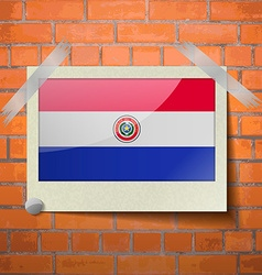 Flags Paraguay scotch taped to a red brick wall vector
