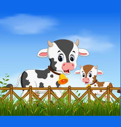 natural view with the cow and her little cow vector image