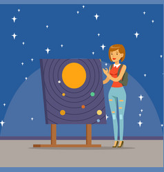 young woman learning about the solar system at the vector image