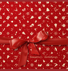 Red bow over red christmas wrapping paper icons pa vector