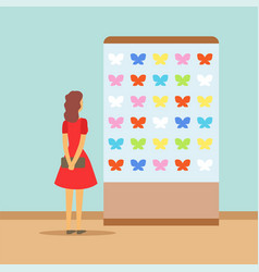 young woman watching butterflies at the exhibition vector image vector image