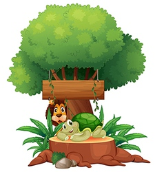 A turtle and a lion under the tree with a wooden vector image