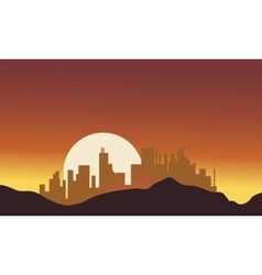 Silhouette of city with big moon vector