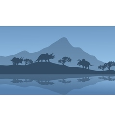 Silhouette of triceratops in the riverbank vector