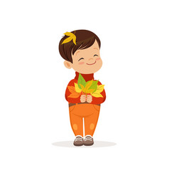 Cute little boy in warm clothing holding colorful vector