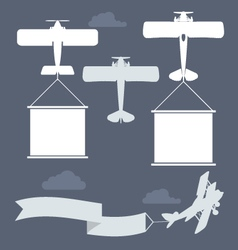 Flying biplanes with blank greetings banner vector image