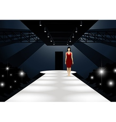 Fashion model in red dress walking down a catwalk vector image