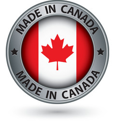 Made in Canada silver label with flag vector image