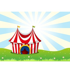 A circus tent at the top of the hill vector image