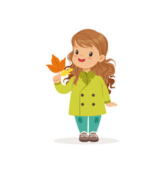 sweet little girl in in green coat holding vector image
