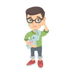 Caucasian boy in glasses crying and holding toy vector
