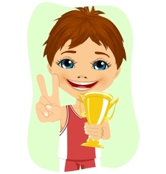 Little boy celebrates his golden trophy vector
