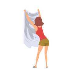 Young woman hanging clean wet clothes out to dry vector