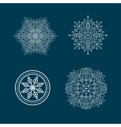 Set of round calligraphic patterns or snowflakes vector image