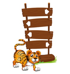 Tiger in front of a wooden signboard vector image vector image