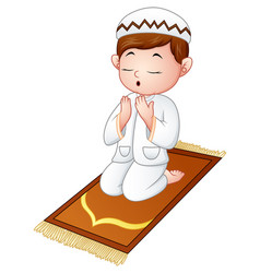 Muslim kid sitting on the prayer rug while praying vector