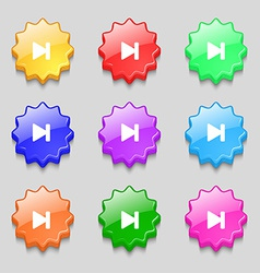 Next track icon sign symbol on nine wavy colourful vector