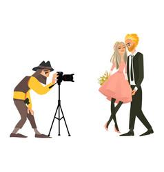 photographer shooting a wedding couple vector image