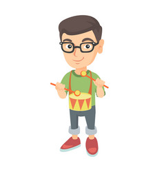 Cheerful caucasian boy in glasses playing the drum vector