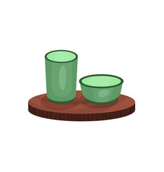 Green teacups on bamboo wooden trivet tea vector