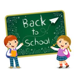 School kids with blackboard vector