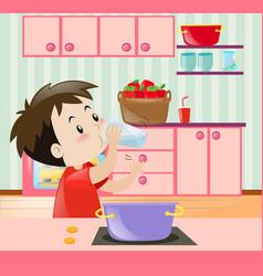 Little boy drinking water in kitchen vector