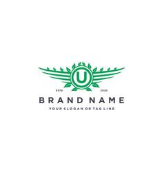 Letter u leaf wing logo design concept vector
