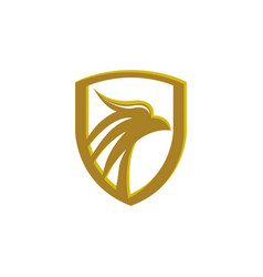 eagle head in a golden shield luxury eagle head vector image
