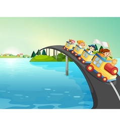 Children riding train over bridge vector