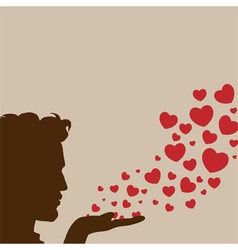 Man blowing heart vector image