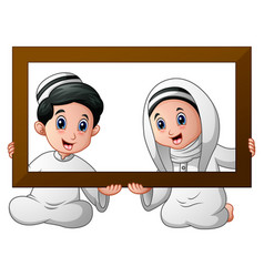 Muslim kid couple holding wood frame and celebrate vector