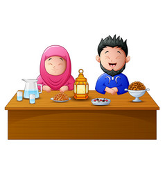 Happy muslim couple break fasting together vector