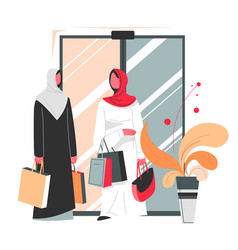muslim women with bags shopping in mall vector image