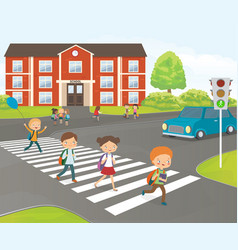School children cross road on pedestrian crossing vector