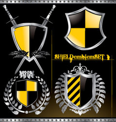 glossy black and yellow shield emblem set vector image vector image