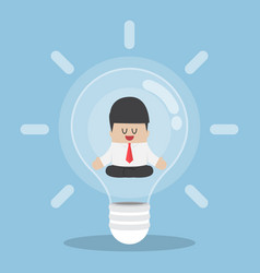 Businessman doing meditation inside light bulb vector