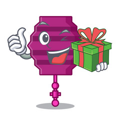 With gift paper lantern mascot cartoon vector