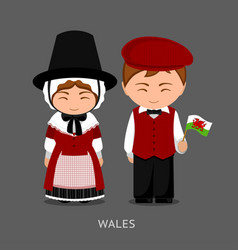 Welsh in national dress with a flag vector